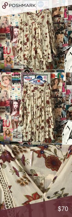 Free People Tunic Floral Free People Tunic. Wear it as a beach cover up on summer days or add black shorts for a fall day look! Gently worn, perfect condition. Free People Tops Tunics