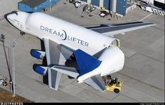 A Boeing Dreamlifter open at Paine Field. The Dreamlifter is used to ferry 787 components to the final assembly lines. Boeing Dreamlifter, Jumbo Jet, Air Space, Commercial Aircraft, Spacecraft, Fighter Jets, Transportation, Vehicles, Airplanes