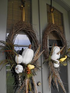Fall Wreath: White Pumpkins, pheasant feathers with a grapevine wreath.  Susie Harris: Recycle. Restore. Renew .Respire. Reflect.