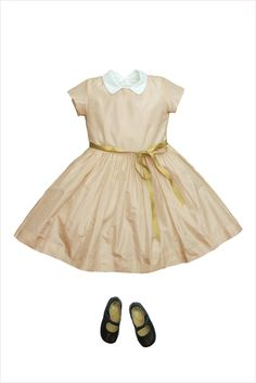 magnificent 100% silk taffeta dress with sweet peter pan collar. comes with a gold ribbon belt that can be removed....