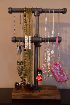 2 Tier Tall Industrial/Urban Jewelry Display Stand,Pipe Jewelry Stand,Industrial Necklace Stand by SawdustandIron on Etsy https://www.etsy.com/listing/211292908/2-tier-tall-industrialurban-jewelry