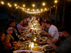 outdoor dinner at one long table at a farm wedding
