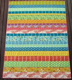 Love these strip quilts!