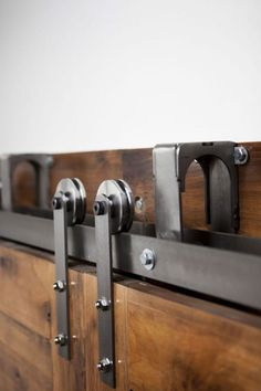 This is our unique Barn Door Hardware Bypass Track System™. Use this ByPassing Sliding Door Hardware to allow for doors to slide in front of and in back of each other to conserve space. Use our ByPassing™ system to take advantage of limited spaces. Pictured With: Color / Finish: Brushed Steel Wheel Type: Steel Wheel