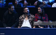 Former footballer Robert Pires, footballer Olivier Giroud of Arsenal and France and his wife Jennifer attend the men's singles final between Roger Federer of Switzerland and Novak Djokovic of Serbia on day eight of the Barclays ATP World Tour Finals at the O2 Arena on November 22, 2015 in London, England.