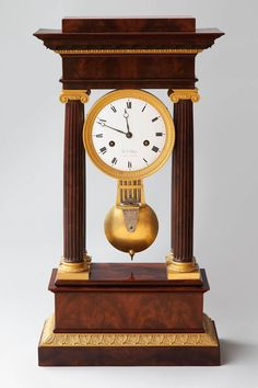 Important Early 19th Century French Empire Flame Mahogany Portico Clock | From a unique collection of antique and modern clocks at https://www.1stdibs.com/furniture/decorative-objects/clocks/
