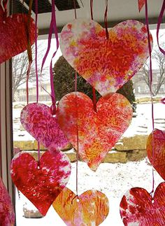 Heart stained glass... Shredded crayons, kids sprinkle on wax paper and fold paper in half, adult irons with a low setting under towel. Cut into shapes punch a hole and tie a ribbon.