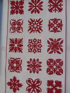 Red and white Hawaiian style quilt