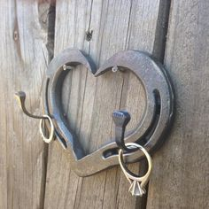 "Made specially for wedding rings, you could also hang your keys or jewelry from this sweet horseshoe heart hook. Made from one of our horseshoe hearts, and 2 horseshoeing nails we are now offering this hook in two sizes due to customer requests. The pony shoe hearts measure approximately 3"" x 4"" and the standard horse shoe hearts about 4"" x 5"" with 1"" horseshoe nail hooks. You can see the size comparison and examples of stamping in the second photo. In the last photo ..."