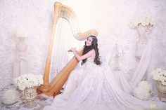 Angela July is an Indonesian singer/harpist who was a finalist in X-Factor and impresses with her sweet voice and clever arrangements for voice and small harp.