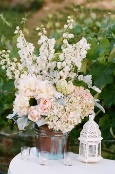 White delphiniums with neutral hydrangea and garden roses and peonies