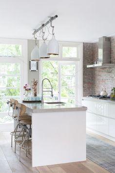 white + wood + brick + industrial lighting + vintage stools