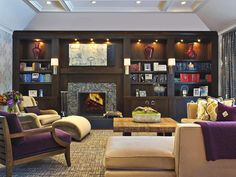 Built-In Bookcases makes off-center fireplace an asset instead of a flaw. Check out the tray ceiling.