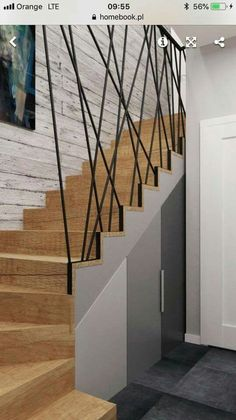 of shelves + make stairs shorter by bend + cabinet? Walls of shelves + make stairs shorter by bend + cabinet? Walls of shelves + make stairs shorter by bend + cabinet? Modern Stair Railing, Stair Railing Design, Staircase Railings, Modern Stairs, Stairways, Railing Ideas, Grand Staircase, Staircase Storage, Stair Storage