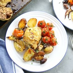 Tender chicken thighs, crispy little roast potatoes, juicy cherry tomatoes & kalamata olives all flavored with garlic, lemon & thyme. Yum!