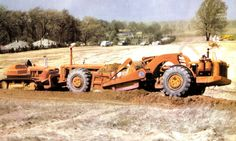 Here's a shot of a TS-18 working on the Indiana Toll Road in 1955. Western Construction painted all its gear this color