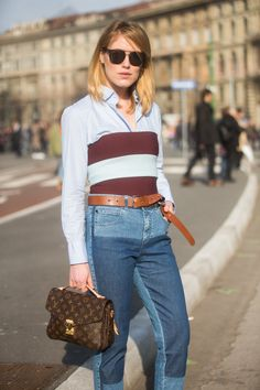 Buyer Annabel Rosendahl wears a Stella McCartney striped top and pants, Dior sunglasses, Acne belt, Riccardo Tisci x Nike Air Force 1 sneakers, and a Louis Vuitton bag at Milan Fashion Week. - TownandCountryMag.com