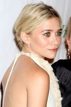 ASHLEY OLSEN FRESH AIR FUND CLOSE UP BEAUTY HALTER DRESS THE ROW LOW BUN HAIR THICK EYEBROWS COPPER SHIMMER EYESHADOW OLSEN FASHION STYLE BLOG