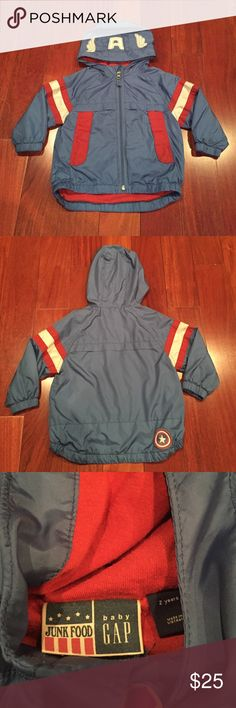 Captain america baby gap windbreaker - 2 years Junk food baby gap collaboration. Size 2 years captain America wind breaker with red cotton lining.  Slight pilling on felt on hood and minor stains on jacket if looking very closely. Otherwise lots of life left. We wish it still fit! Major favorite in our house.  Ran big! Junk Food Clothing Jackets & Coats