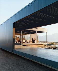 With this elegant steel prototype, Marmol Radziner and Associates launch a new prefab venture with the goal of bringing their modern design sensibilities to a broader market. — Frances Anderton  Leo Marmol and Alisa Becket enjoy one of their home's many outdoor spaces.  Photo by: Daniel Hennessy