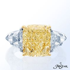 Style 4958 Natural fancy yellow diamond ring featuring an exceptional 7.04 ct fancy yellow cushion diamond, embraced by trapezoid and shield diamonds. Platinum/18KY @jewelsbystar