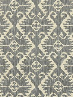 A traditional ikat upholstery fabric in grey and ivory. This mid-weight fabric is suitable for living room furniture, benches, and fabric