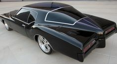 71 Buick Riviera. One of the most interesting rear end designs of all time. I love these 71-73 Boat tail Rivieras.