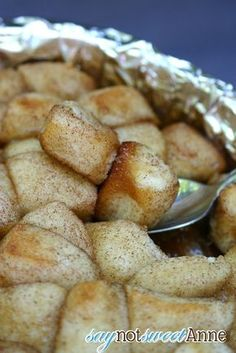 Easy and Delicious camp fire monkey bread (good on a grill too!) Only a few ingredients, and only one that needs to be kept cool.   saynotsweetane.com