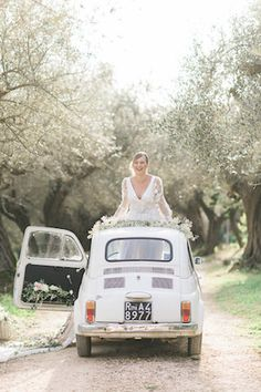 Flower filled car | Alexandra Vonk | see more on: http://burnettsboards.com/2015/10/dream-wedding-italy/