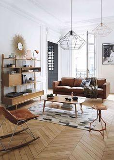 Love the herringbone floors, the natural light and walnut sofa