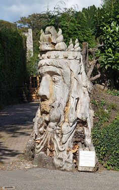 The village of Charlestown near St. Austell. This sculpture of an old tree stump is Neptune