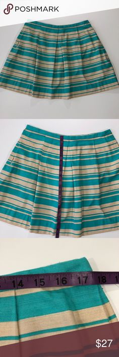 """Gap Turquoise & Beige Skirt size 14 NWT Gap skirt, size 14, a-line, turquoise & beige, pleated, striped, 2 front pockets, zipper back with closure, never worn Approx Measurements: (taken laying flat) Waist: 17.5"""" across Length: 19.5"""" Materials: 100% cotton GAP Skirts A-Line or Full"""