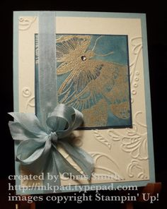 I played with the sponges on this one, embossing Swallowtail in gold and layering on Baja Breeze, Marina Mist and Midnight Muse. A single rhinestone embellishes the body of Stampin' Up!'s popular butterfly, Swallowtail. The stamped piece is mounted on...