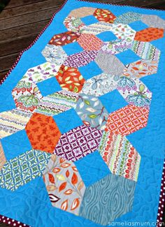 Entwined Quilted Table Runner Tutorial - uses a charm pack and 1/2 yard of fabric