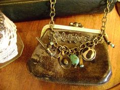 altered coin purse... Love this as a necklace - a nice little place for some bills and and an ID when you don't want to carry a purse.