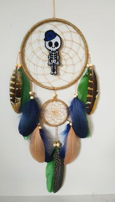 Gothic wall hanging dreamcatcher feathers, skeleton Halloween wall decor Materials: ~ metal rings hand wrapped in natural color jute cord ~ tan nylon string ~ wooden beads, gold beads ~ goose and pheasant feathers ~ embroidery skeleton Dream Catcher Decor, Feather Dream Catcher, Halloween Wall Decor, Pheasant Feathers, Halloween Skeletons, Hand Wrap, Gold Beads, Wooden Beads, Jute