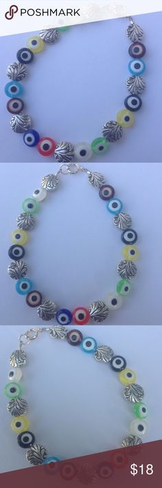 Evil Eye Bracelet Colorful evil eye bracelet with silver detailed spacers ending with sterling silver clasp. Always good for your protection. Please check out my other items in my closet for a bundle discount. PRICE FIRM UNLESS BUNDLED. Cindylou's Design Jewelry Bracelets