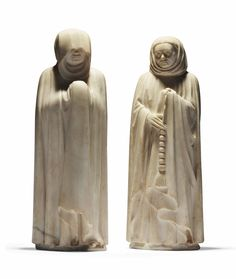 TWO CARVED MARBLE MOURNERS FROM THE FUNERARY CORTEGE OF THE TOMB OF JEAN DE FRANCE (1340-1416), DUC DE BERRY, BY JEAN DE CAMBRAI (KNOWN FROM 1375 TO 1438), BOURGES, CIRCA 1396-1416