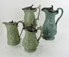 Lot: Green parian/stoneware lot of 4 molded jugs with, Lot Number: 2514, Starting Bid: $50, Auctioneer: Strawser Auction Group, Auction: Antique Auction Day #3, Date: September 29th, 2017 EDT
