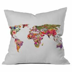 Made in the USA, this chic pillow showcases a world map motif with floral overlay for a touch of wayfaring style.  Product: PillowConstruction Material: Woven polyester cover and polyester fillColor: WhiteFeatures:  Designed by Bianca Green for DENY DesignsMade in the USAInsert included Cleaning and Care: Machine wash cold. Tumble dry low.