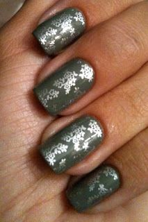 Gray nails with stamped silver flower accent.