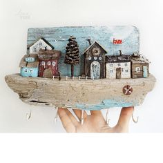 Image may contain: outdoor Driftwood Projects, Driftwood Art, Pebble Painting, Painting On Wood, House Ornaments, Wooden Picture, Ceramic Houses, Wooden Art, Love Craft