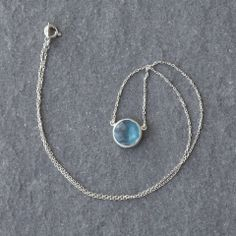 This sterling silver necklace, with a small semi-precious blue topaz gemstone, is a simple and elegant piece of jewellery. Sterling silver and nickel free.