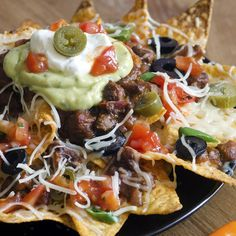 Nachos supreme is great served for guests to snack on. Serve with extra guacamole and salsa for dipping.. Nachos Supreme Recipe from Grandmothers Kitchen.