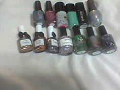 Top Row L to R - CBL Piece of Me (, Sparkles are a Girls Best Friend (20.00), Jindie Nails rave (3.00), Chrome Girl Schmexy(8.00), Worth the Wait (8.00), SpaRitual It's Raining Men (7.00) Last Row L to R - Esmaltes de Kelly The Forgotten (5.00), Orange Sunset (5.00), Centauro (5.00), Glitzology Cotton Candy(5.00), Darling Divas Screaming Butterflies, Space Beetle, Carebear for a Crow All DD - 12.00 each