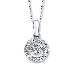 A round diamond sparkles with your every move in the center of this lovely necklace for her from the Diamonds in Rhythm™ collection. Additional round diamonds set in sterling silver halo the center. The pendant sways from an 18-inch box chain secured with a lobster clasp and has a total diamond weight of 1/5 carat. Diamond Total Carat Weight may range from .18 - .22 carats.