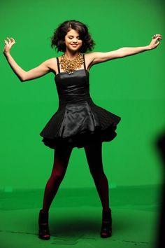 #SelenaGomez: Black dress with red tights and heels--Fun and formal! Shop DivaMall.tv