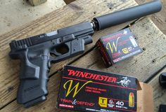 Ammo Test: Winchester Train and Defend .40 S&W, We tested the .40 S&W Winchester Train and Defend in several different guns including this suppressed Glock.