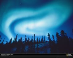 National Geographic  The sky over Yellowknife, Northwest Territories, Canada, churns with light from an aurora borealis (photograph by Paul Nicklen).