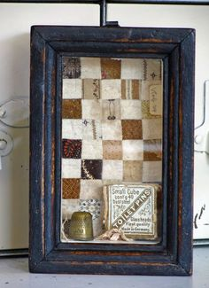 What a wonderful way to display old notions and bits of antique quilts, how clever!